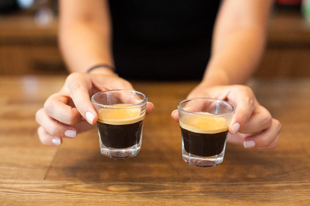 woman serving espresso